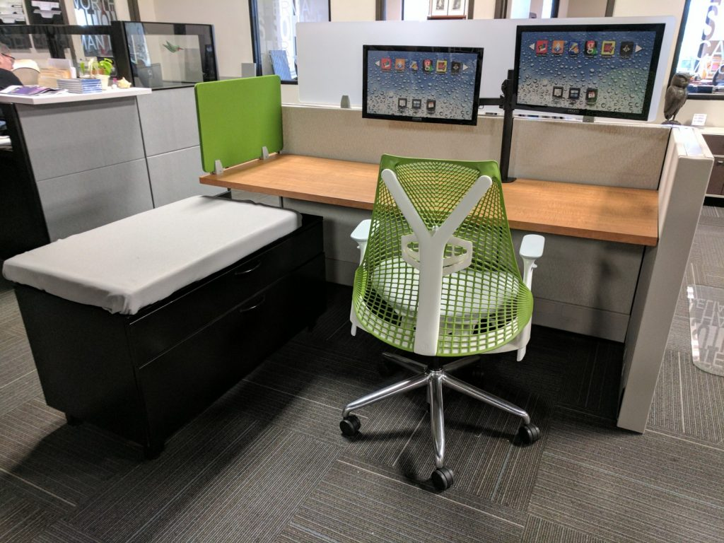 black wood and green workstation. Wood desktop, white base and black cabinets with white padded top
