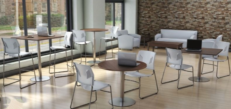 breakroom with several tables and chairs. Tables are cherry with white and metal chairs