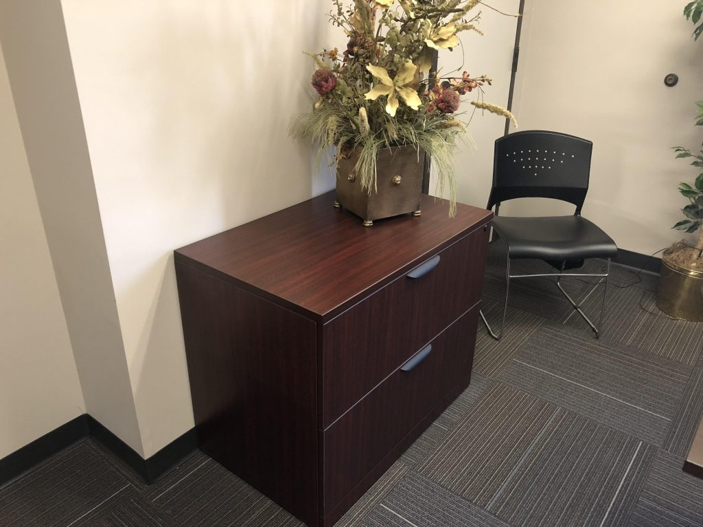 dark wood lateral filing cabinet with two cabinets, modern handles and single lock angled view
