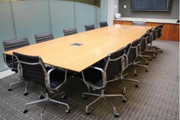 12' veneer conference table with wood top and 12 black leather office chairs