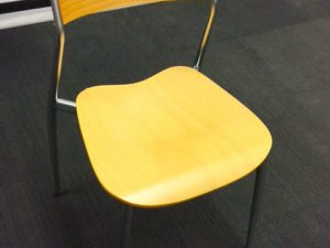 chair with yellow wood seat and black and metal frame