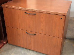 cherry lateral with two drawers, modern handles and one black lock