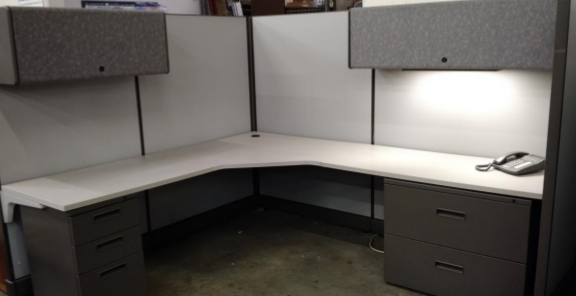 white and dark gray workstation with phone