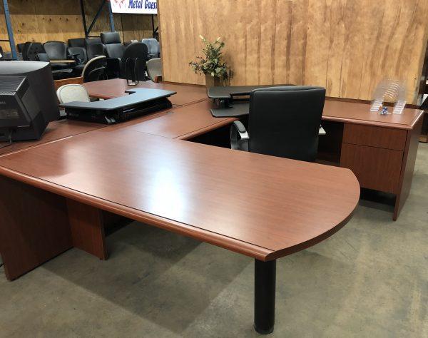 steelecase peninsula desk with black chair and folder organizer