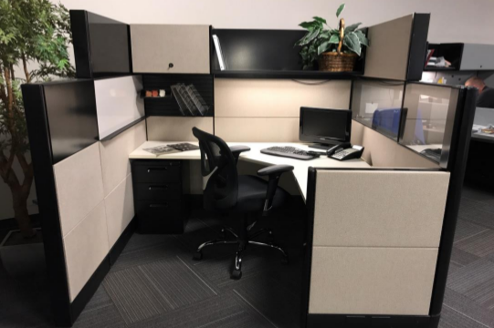 white and black tiled workstation with overhead cabinet and shelf, black chair and black desktop