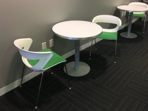 green and white breakroom table and chairs