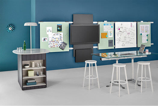 blue and aqua cubicle mockup with glass desktop and three white stools and cabinet with rounded white top