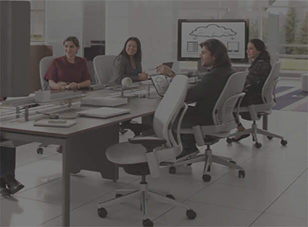 stock photo with dark overlay of employees at a conference table in white office chairs