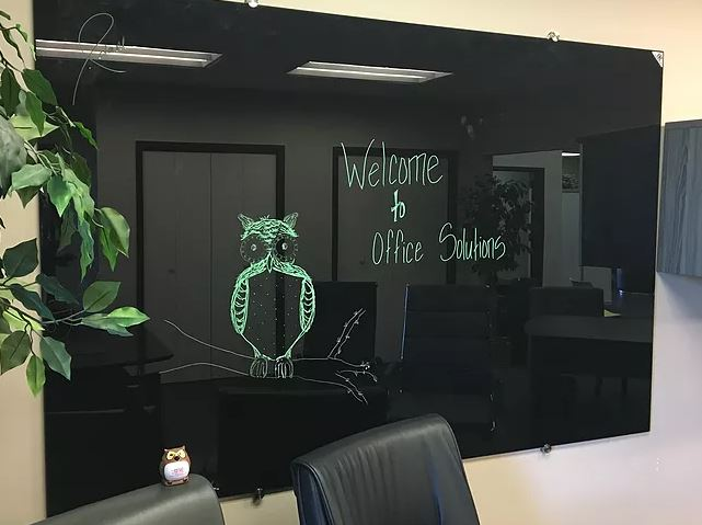 Glass marker board with owl drawn on it